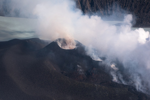 Large volumes of stone and cooling lava can be seen spewing non-stop from two new vents in the volcano on top of Ambae's mount Lombenben.