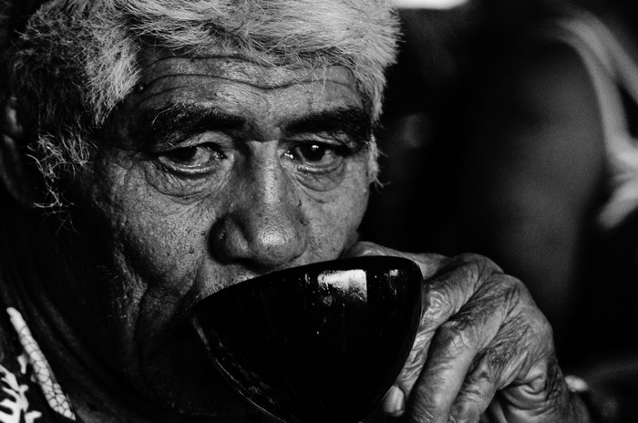 Old man drinking kava
