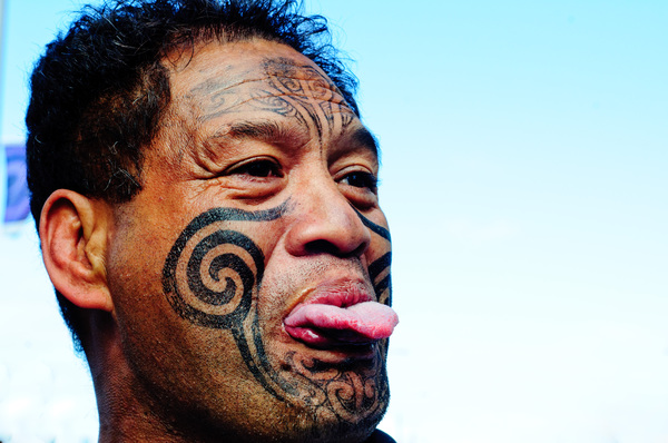 A maori man celebrates the All Blacks' imminent victory in the 2011 Rugby World Cup final.