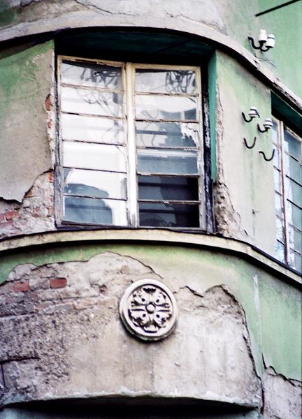 A fairly typical house facade in downtown Belgrade, featuring construction reminiscent of better times, and the very clear effects of neglect and decay.