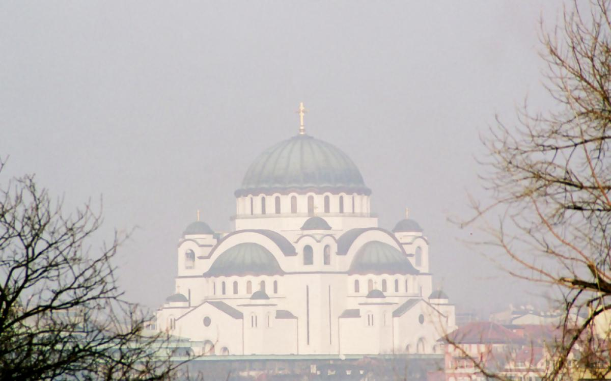 The massive yet airy bulk of Sveti Sava church dominates the Belgrade skyline. It balances the bulk of the great mosques of its time with lighter italianate influences reminiscent of the Duomo in Florence. This view, through the ever-present haze of urban smog, enhances its feeling of lightness.
