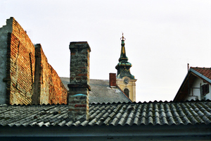 Zemun, once a separate village but now a suburb of Belgrade, once marked the eastern edge of the Austro-Hungarian Empire. As a result, it has a markedly more '<i>Mittel Europan</i>'  feel to it than other neighbourhoods. This view across the rooftops captures a little of its feel.
