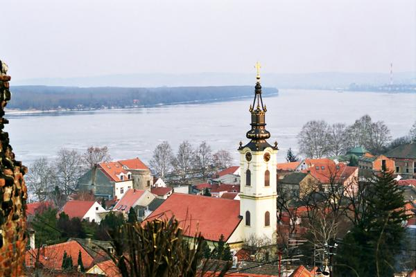 Zemun, once a separate village but now an suburb of Belgrade, once marked the eastern edge of the Austro-Hungarian Empire. As a result, it has a markedly more '<i>Mittel Europan</i>'  feel to it than other neighbourhoods. This photo, taken from the heights overlooking the town, shows the Danube river in the background.