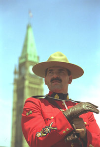 This is my compulsory 'Don't you Love a man in uniform?' shot. Taken on Canada Day, 1999, this shot just goes to show that sometimes the stereotypes are true. This man was dashing, kind and gallant toward  everybody he met that day.