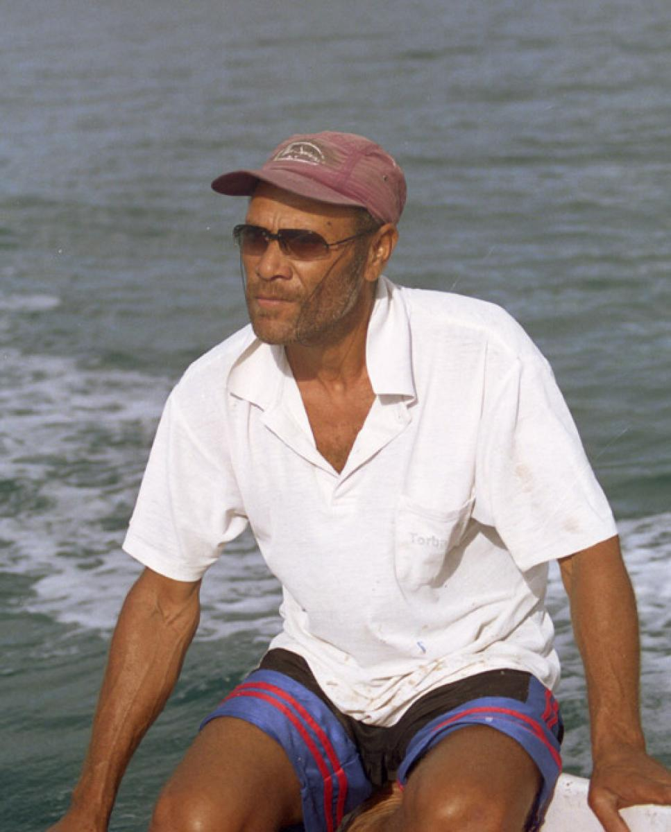 "On our last full day on the island of Vanua Lava, Jimmy and I hopped into the 20-foot open boat that had been chartered to pick up some friends from the other side of the island. The man who operated the boat was known to all simply as the Captain. I never heard him referred to by any other  name. His father is fond of telling the following story: When the Captain was born, his right fist was clenched tightly shut. His apu (grandfather), on seeing this, intructed those present to open it carefully. The infant's hand contained a small amount of water. ""Taste it,"" said the apu. It was as salty as the ocean. There are times when it makes sense to go along with folk wisdom, and believe me, when I saw the skill with which the Captain angled us through the 2 1/2 metre swell, I knew that, no matter what its provenance, this man  has salt water in his veins."