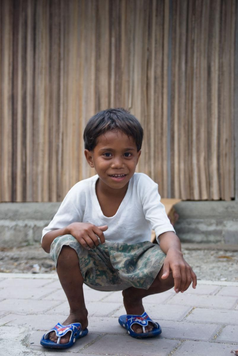 I tried to take a low-angle shot of a roadside shopkeeper's son, but he followed me down. Oh well, cute shot nonetheless.