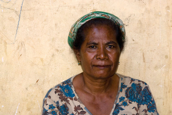 Over 40,000 people still occupy camps for Internally Displaced Persons in and around Dili, Timor-Leste. This woman was among hundreds who crowded a tiny yard, waiting to be processed by yet another humanitarian organisation.