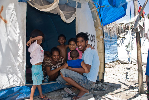 A scene from the camp for Internally Displaced Persons in Dili. Over 40,000 people still occupy camps like this. This young man, named August, took it on himself to give me a tour of the entire camp. He's pictured here with his family in the tent they've shared for nearly two years now.