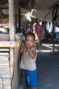 Children at one of Dili's many roadside markets.