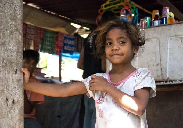 A girl at one of Dili's many roadside markets.