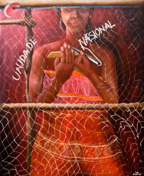 Liberation art from the offices of the East Timor Development Agency. This NGO sponsored the piece, created by an artist with no prior experience. This particular piece shows a woman mending her fishing nets with a potent message.