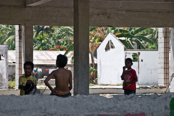 These young boys took over a building ruined during Indonesia's calamitous scorched-earth campaign prior to their departure in 1999. The main floor now serves as a nicely shaded futsal court.