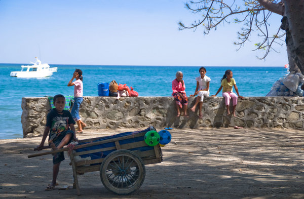 Hundred of people live and work along Dili's seafront.