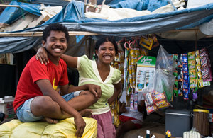 Two members of the family who kept an impromptu roadside store under a tarpaulin down the road from my hotel. They slept on the pavement and amid the stock to protect their investment.