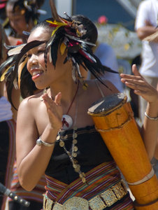 This woman was one of a troupe of dancers performing for a tourism promotion event.