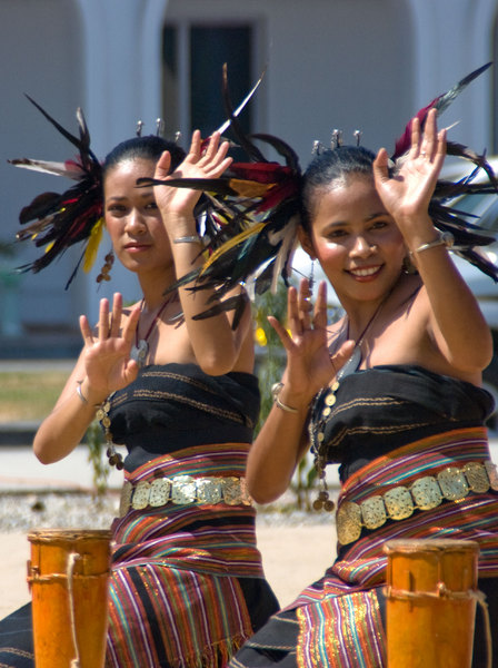 Two of the many dancers who performed at a celebration promoting tourism in Timor-Leste. This was one of a series of public events that the government used to gather people together peacefully. They were entirely successful.