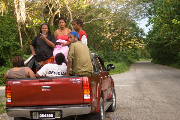 A group of friends prepare to return to Honiara following a  day at the beach.
