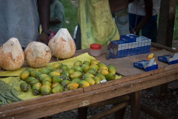 Betel nut, cigarettes and fresh coconut: everything one could ask for on a day at the beach.