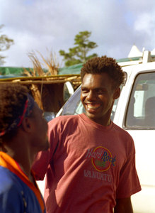 Kiwanis Race day is a huge event in Port Vila. Nearly a third of the population gathers on the Elluk heights overlooking Port Vila harbour to watch the finest horses in the nation show their mettle.  Two young men joke around in the parking lot outside the track. The shirt, by the way, is hand-painted. There is no Hard Rock Café in Vanuatu.