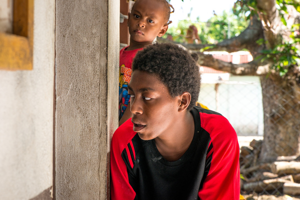 A boy peeks into the door of the community clinic on Ifira island, as he waits for his younger brother, who was experiencing respiratory problems.