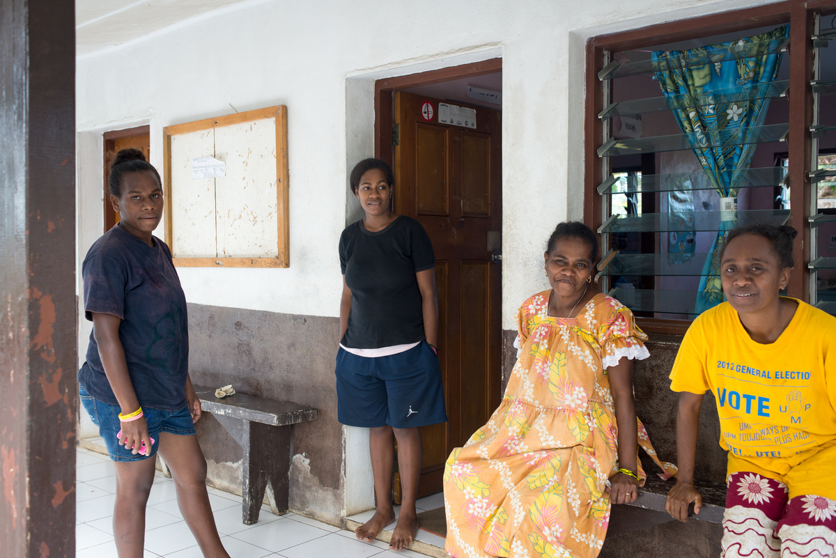Women gather at the entrance to the Ifira island community clinic.