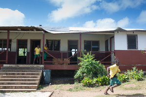After cyclone Pam tore the roof off the English school on Ifira island, locals laid the corrugated sections back in place and covered the bare area with the tarpaulin. Three months later, no further repairs have been done.