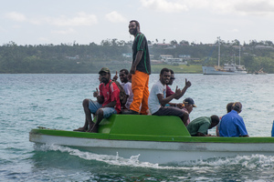 A water taxi carries residents back to Ifira island.