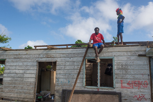 Members of Wilma's extended family at work renovating the family home on Ifira island.