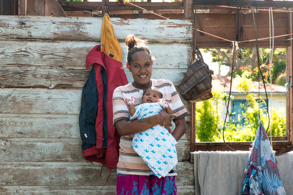 Wilma Kaltiriki and her newborn son, Francois, at home on Ifira island. Their house has yet to be fully repaired after it was badly damaged by cyclone Pam.