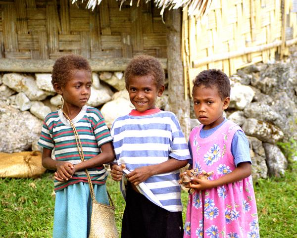 These three small children followed us for about half a  kilometre as we walked around the village of Loltong in  Pentecost.