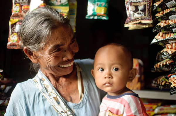 A Balinese woman and her grnadchild. Taken in Mataram, Lombok Praya, Indonesia.