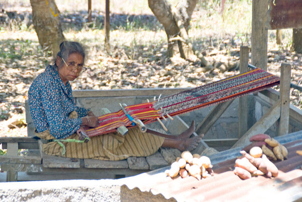 A woman at work at her loom. The traditional fabrics in Timor-Leste are fascinatingly complex in design.