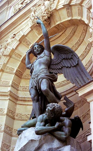 This statue - one of the symbols of Christian France retrieved from  mediaeval times - stands in ironic contrast to its environs. Place st Michel is the gateway to the Left Bank, and is populated by  students, street vendors, vagrants and dealers. In this context, the devil doesn't seem so much vanquished as telling the Christian conqueror to get off his back.