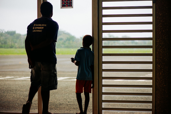 Father and son await the last flight out of Luganville, Santo.