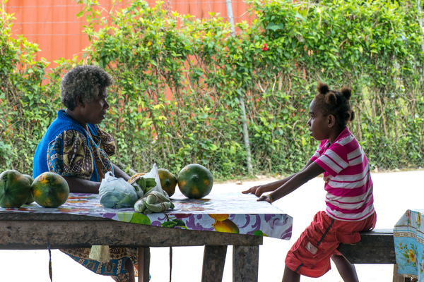 Grandmother and granddaughter confer at Santo Market.