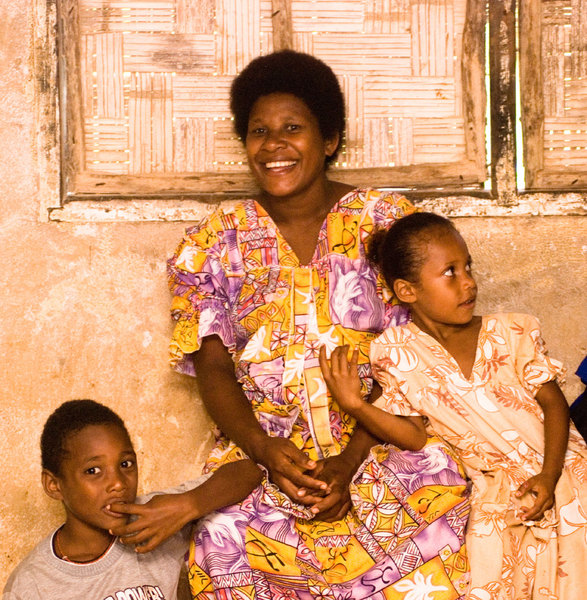 A mother with her children. I love the line and deeply saturated colour of this shot.