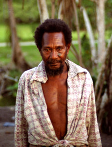 "This man, a neighbour of ours while we stayed in Sola, was the creator of one of the best-known landmarks in Vanuatu: An eight-foot tall pig's tusk (for reference, <a href=""http://www.janeresture.com/vanuatu_pictures/tNew%20Hebrides%20Vanuatu%20RARE%20PIG%20TUSK%20CURRENCY%20usk.jpg"">here's a real one</a>) that stands outside Pekoa airport on Espiritu Santo. The tusk is a little amusing at first, until you consider how it was made. By way of a hint, there aren't many facilities in Vanuatu to create, for  example, fibreglas forms to mould the concrete. This man completed the task without any tool more advanced than a machete. He appears to be mentally impaired in some way, perhaps with some mild kind of autism or Asperger's syndrome. He readily recognises and welcomes friends and family members, but does not respond in any way to spoken or signed language. He's a brilliant individual."