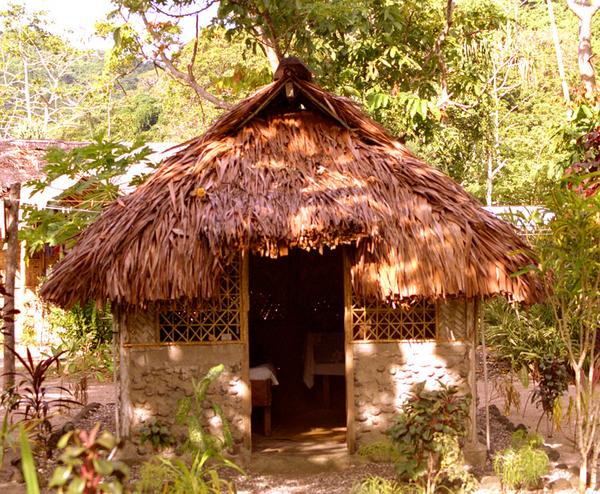 While I was in Sola, I stayed in a tiny but beautiful beach-side bungalow.  The walls and the door are about five feet tall.