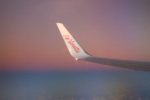 The wing of Air Vanuatu's 737 catches the last of the afternoon light.