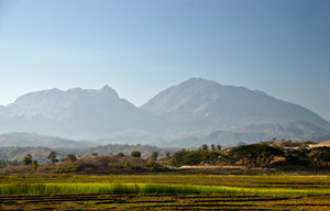Mountains loom over the countryside near Baucau on the road to Los Palos.