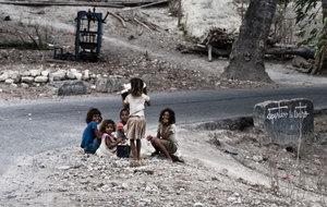 I can't count the number of children I saw hanging out on the roadside, watching the world go by them.