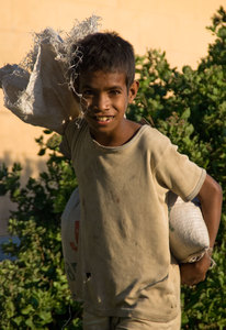 Children work from an early age in Timor-Leste.