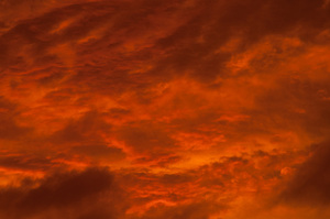 The day after Cyclone Atu passed, a lurid sunset cast an ethereal glow across the town.