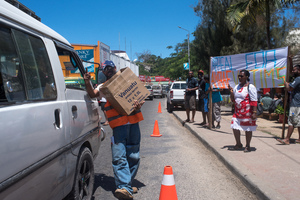 Volunteers conduct a roadside fund-raising activity in aid of evacuees from Ambae's volcano.