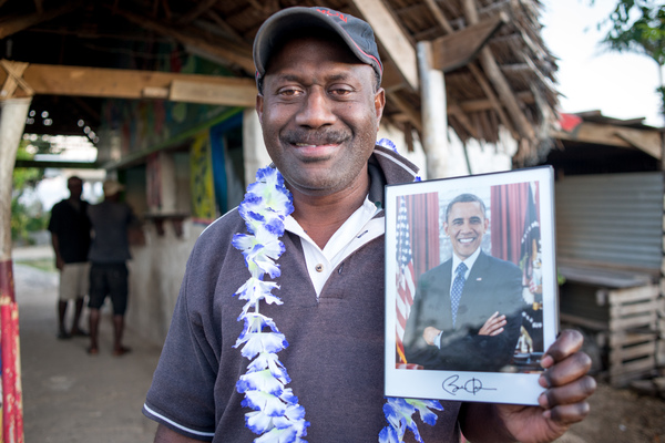 Didier proudly shows his new autographed portrait of US President Barack Obama.