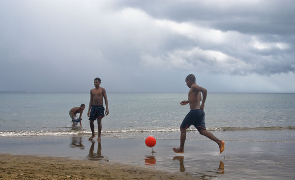 Even an imminent squall wasn't enough to quench their love of the beautiful game.