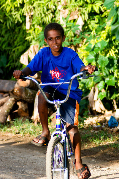 One of the local kids on his new bike.
