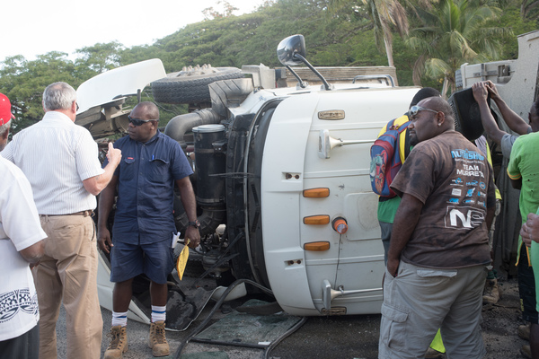 The driver of a container carrier was shaken but not seriously injured when his vehicle overturned at the USP roundabout. Traffic was snarled in all directions.