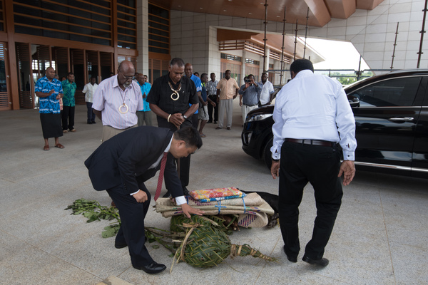 Chinese Ambassador Liu Quan and Vanuatu PM conduct a kastom ceremony, watched over by venerable chiefs.