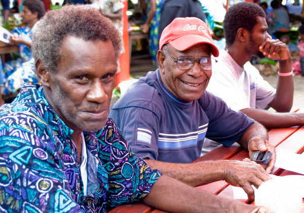 Taken at a Digicel event in Port Vila's market building. Digicel staff demonstrated their new GPRS service to interested people. For these two men from North Efate, it's probably their first exposure to the Internet.